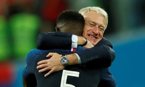 Didier Deschamps hugs France's goalscorer, Samuel Umtiti, after the 1-0 win over Belgium.