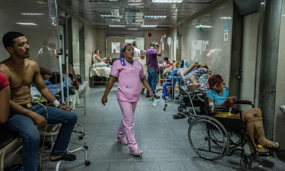 Patients awaiting emergency care fill a hallway at Luis Razetti Hospital in Puerto la Cruz, Venezuela.