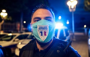 Nice, France A police officer wearing a mask with a police badge during a gathering to protest against the interior minister