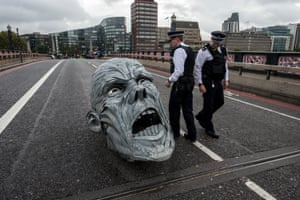 London, UKPolice remove protest infrastructure on Lambeth Bridge. Extinction Rebellion occupied several sites around Westminster in protest and direct action against climate change