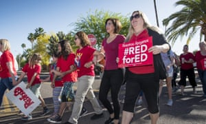 Teachers stage a 'walk-in'' demonstration before the school day begins at Pueblo elementary school in Arizona this week.