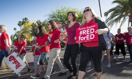 Teachers stage a 'walk-in'' demonstration before the school day begins at Pueblo elementary school in Arizona this week.