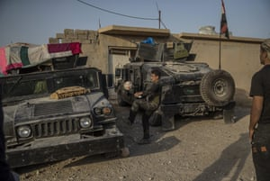 Iraqi special armed forces rest in a village formerly controlled by Isis