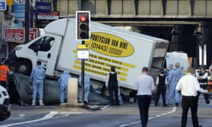 Forensic officers move the van that struck pedestrians near a mosque in Finsbury Park
