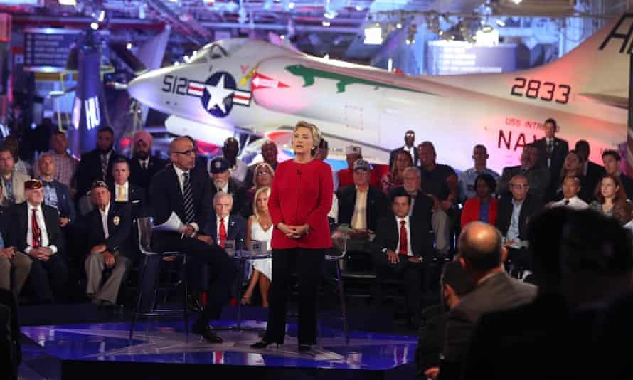 Matt Lauer looks on as Hillary Clinton speaks during the NBC forum in Manhattan on Wednesday night.