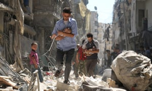 Syrian men carrying babies make their way through rubble following an airstrike on Sunday on the rebel-held Salihin neighbourhood of Aleppo. Airstrikes since the deal was announced on Saturday have killed 74 people, a monitoring group has said.