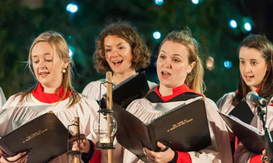 The choir of St Martin in the Fields sing carols on stage.