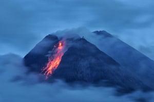 Mount Merapi volcano spews lava during an eruption, as seen from Sleman, Yogyakarta on 17 January 2021