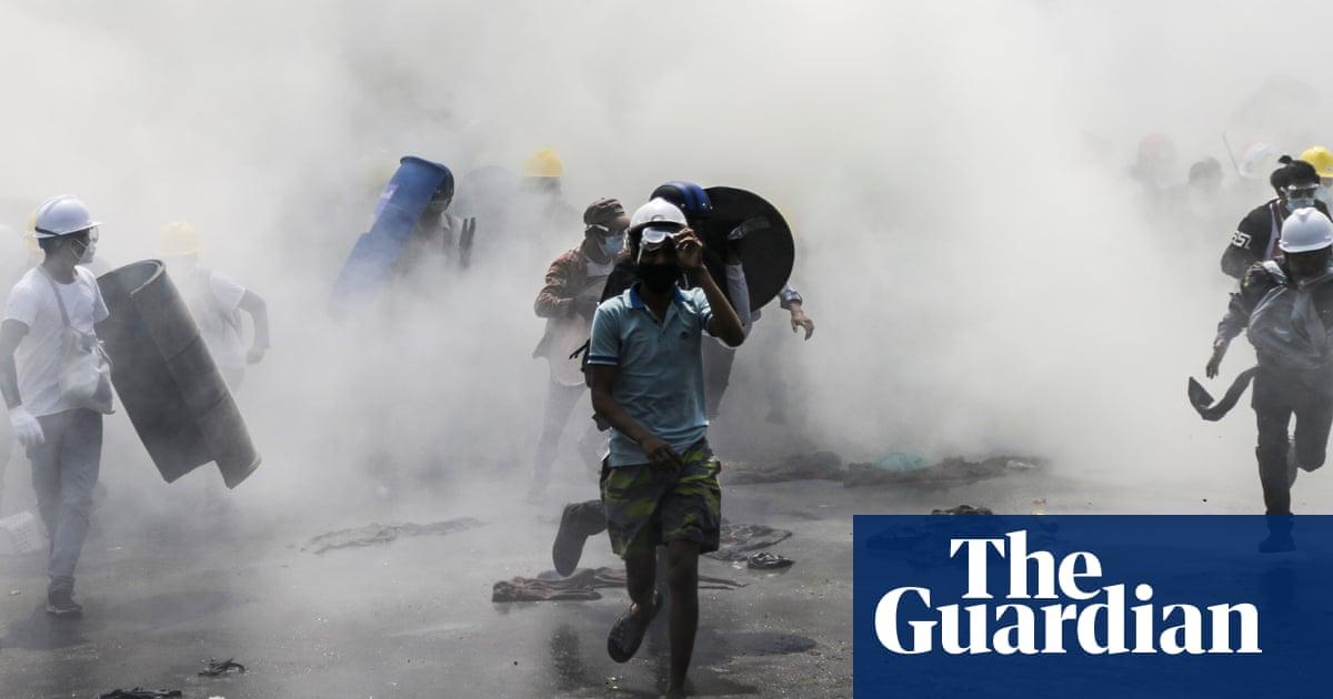 Myanmar: police fire stun grenades at protesters in Yangon – video