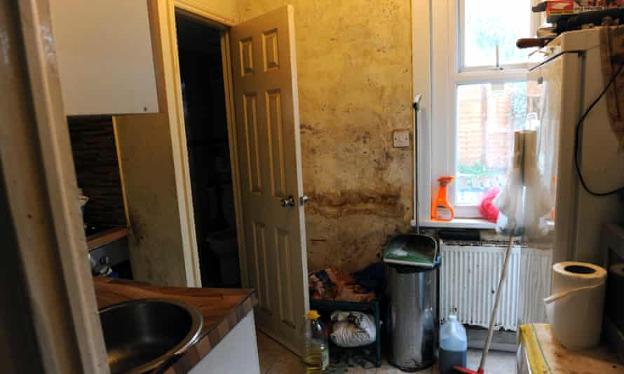 The kitchen of a rented property in Newham. The door leads to the toilet and shower, also in state of disrepair.