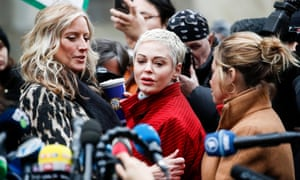 'All voices are valid' … Rose McGowan, centre, stands with other accusers of Harvey Weinstein outside the New York Supreme Court on the first day of his criminal trial in January 2020.