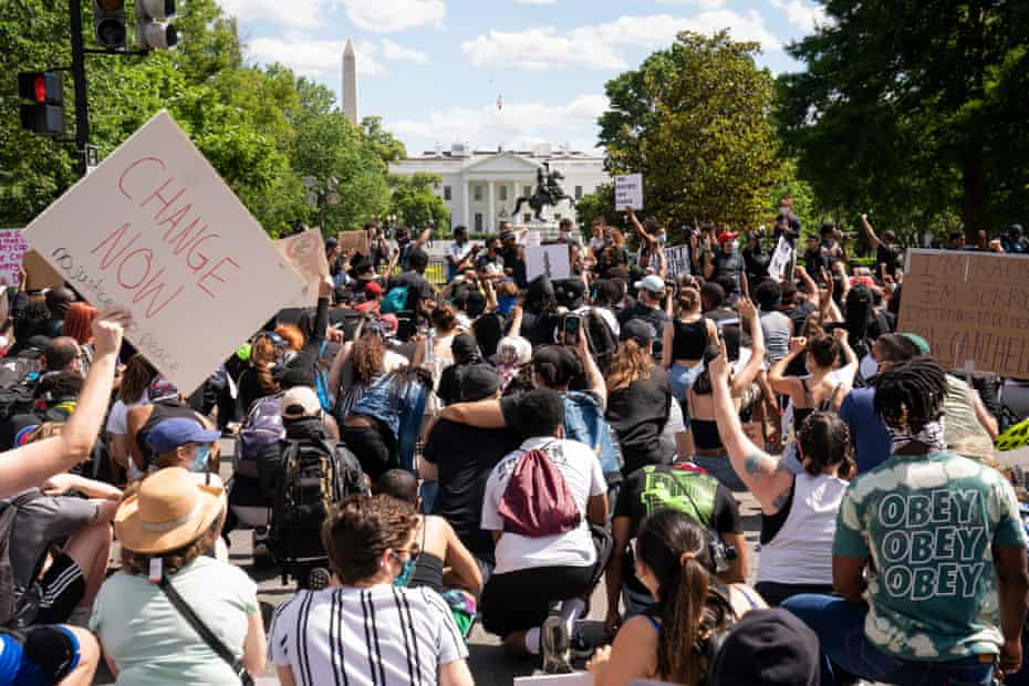 Protesters gather outside the White House on Sunday.