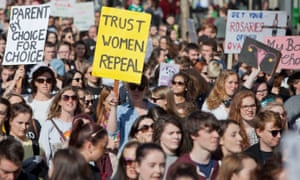 Demonstrators march in Dublin to demand change to Ireland's abortion laws.