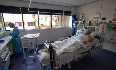 Doctor and patient in Covid ICU ward