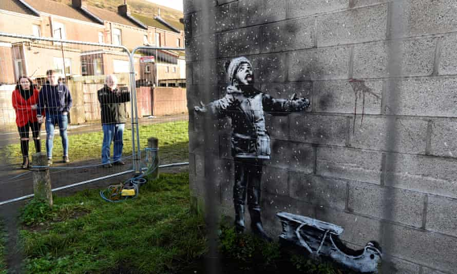 The Banksy artwork appeared on the walls of a garage in Port Talbot.