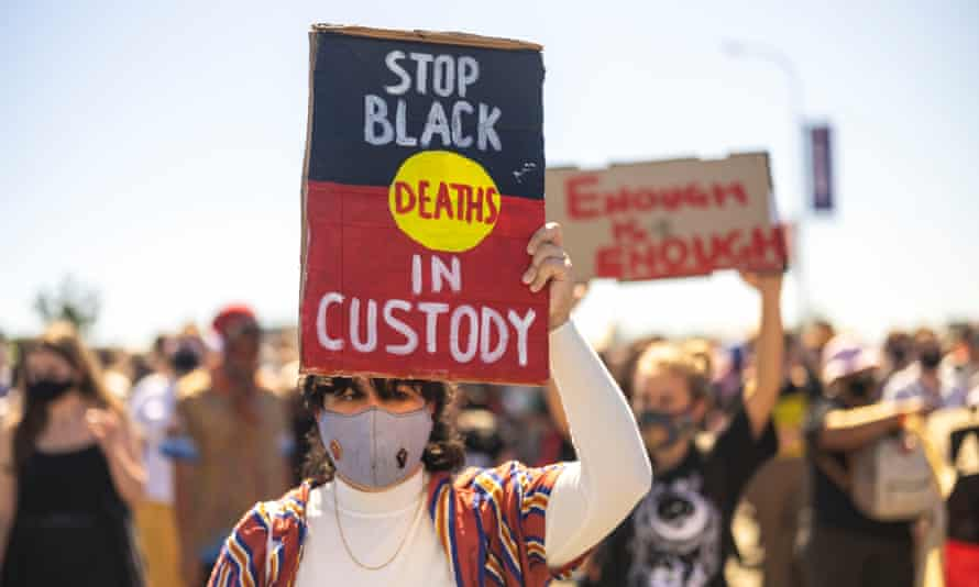 rally with Stop Black Deaths in custody sign