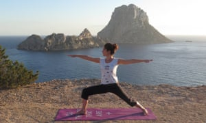 Jane on a sunset yoga session, with magnetic Es Vedrà in the background.