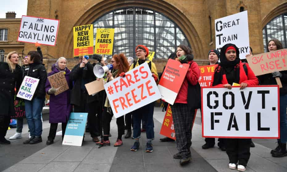 Protesters outside Kings Cross station in London.