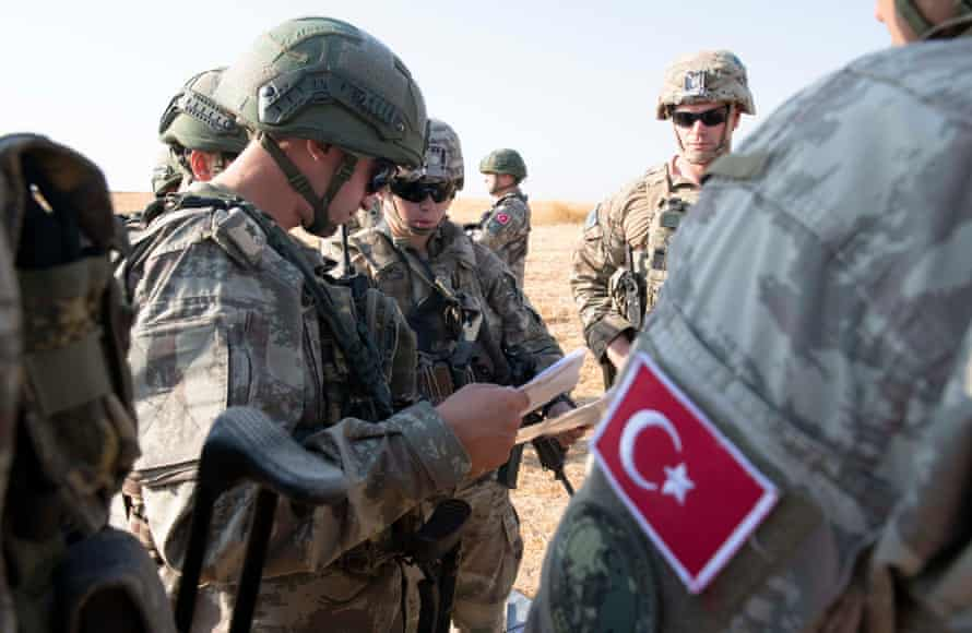 US and Turkish military forces conducting the third ground combined joint patrol inside the security mechanism area in northeast Syria, 4 October. The patrol allowed both militaries to observe first-hand progress on destroyed fortification that are a concern for Turkey