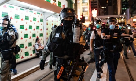 Riot police secure an area as they detain protesters during a rally in Central.