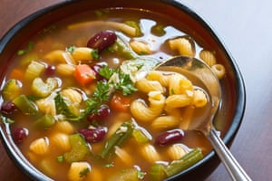Giorgio Locatelli tries to scoop everything at once with a minestrone.