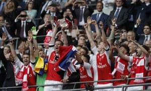 Laurent Koscielny and Per Mertesacker hoist the trophy high.
