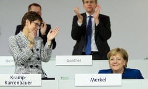 Annegret Kramp-Karrenbauer applauds Angela Merkel.