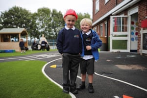 Children pose for a picture on the first day back at the Barnton Community Primary school in Barnton, Cheshire