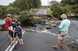 People at a washed out section of road at Port Stephens on the NSW mid-north coast