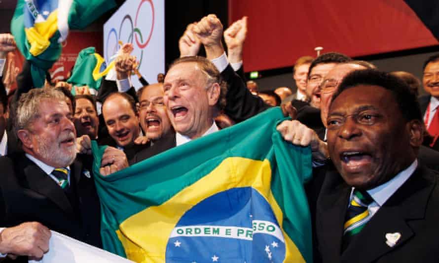 Brazil's President Lula da Silva, Rio 2016 president Carlos Nuzman and football legend Pele celebrate in Cophenhagen in 2009 after Rio won its Olympic bid
