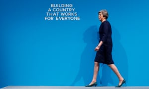 Theresa May walks on stage at the Tory party conference.