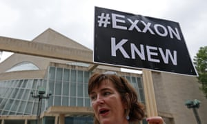An activist protests outside Exxon Mobil's annual shareholder meeting in Dallas in 2016.