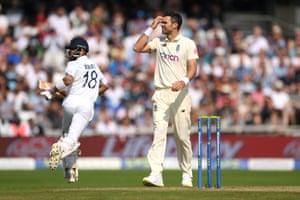 England bowler James Anderson reacts as Virat Kohli glances for four.