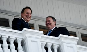 Panama's President Juan Carlos Varela, left, and the US secretary of state Mike Pompeo talk on a balcony after a meeting at the Palacio de las Garzas in October 2018.