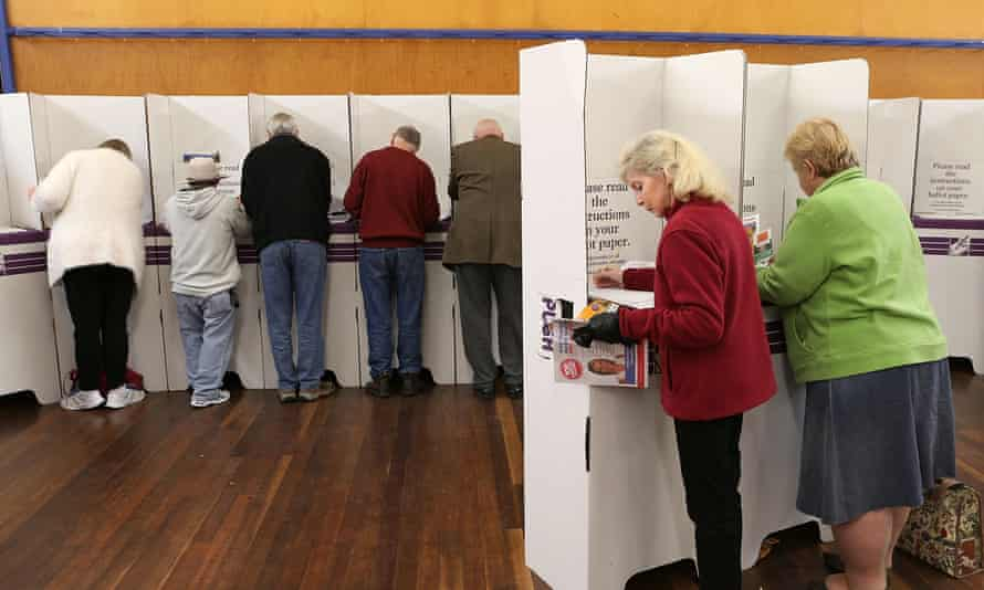 Voters fill in their ballots at East Gosford public school in the electorate of Robertson