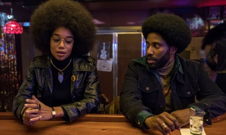 Laura Harrier as Patrice Dumas and John David Washington as Ron Stallworth in Spike Lee's BlacKkKlansman.