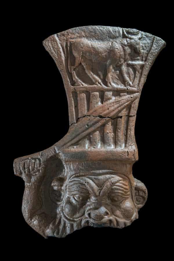 Ceramic depicting the god Bes raising a dagger.