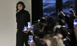 Victoria Beckham greets the crowd after showing her collection during New York fashion week.