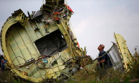 A Malaysian air crash investigator inspects the crash site of flight MH17