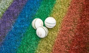 Cricket balls on rainbow grass