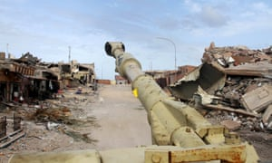 The barrel of a tank belonging to Libyan government forces is seen near the frontline of fighting with Islamic State militants in Sirte