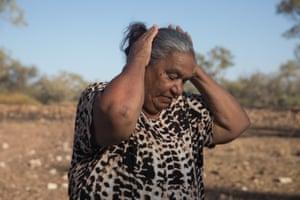 Gamilaraay elder and cultural educator Brenda McBride standing in the empty Narran river north of Lightning Ridge