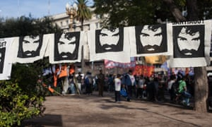 Signs hang in Plaza de Mayo during a rally on the one-month anniversary of Maldonado's disappearance.