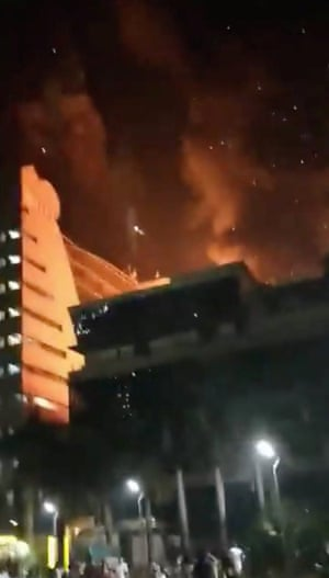 Fire rages at the multi-story building.