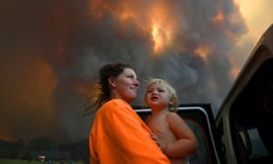 Sharnie Moren and her 18-month-old daughter Charlotte looking on as bushfires burned near Coffs Harbour.