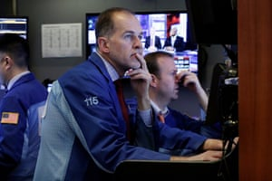 Trader Mark Puetzer works in a booth on the floor of the New York Stock Exchange rtoday