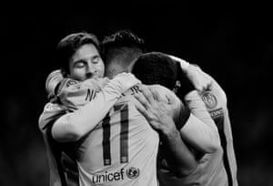 Lionel Messi of Barcelona (left) celebrates scoring the 1st goal with Luis Suarez (right) and Neymar (centre) during the Arsenal v Barcelona Champions League last sixteen first leg match at the Emirates Stadium
