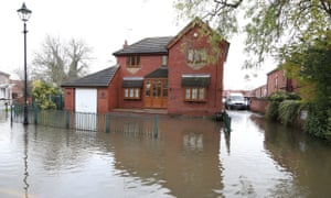 A house surrounded by water in Fishlake, near Doncaster, following flooding.