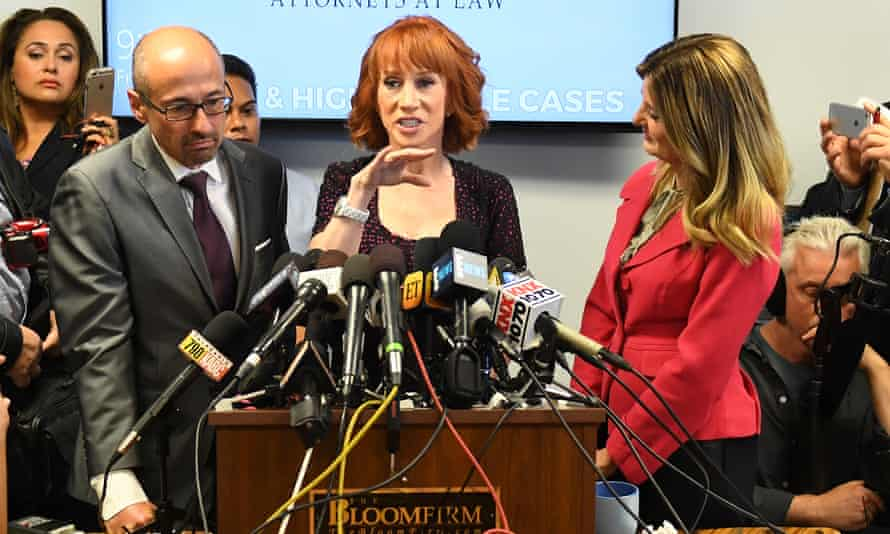 Kathy Griffin gestures during a news conference to discuss the fall out from her 'severed head' photoshoot