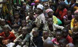 Refugees who fled Burundi's violence and political tension wait to board a UN ship on Lake Tanganyika, Tanzania, to be taken to the port city of Kigoma